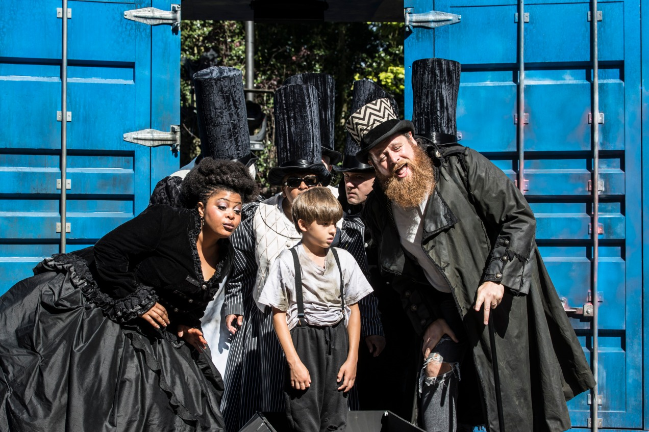 Gbemisola Ikumelo, Lewis Fernée and Daniel Hoffmann-Gill as Mrs Corney, Oliver and Mr Bumble. Photo Johan Persson.
